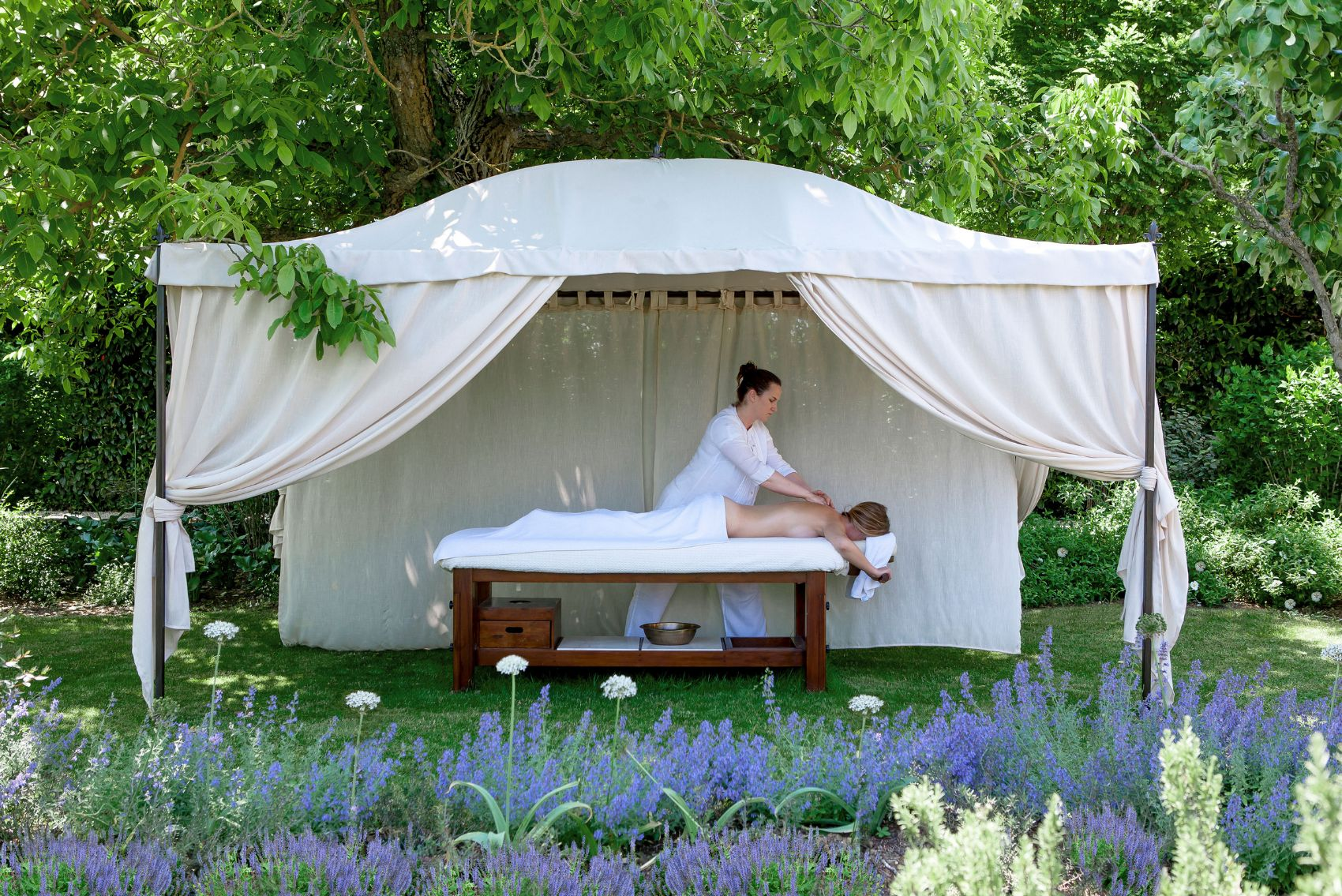Spa massage in a garden of Borgo Santo Pietro